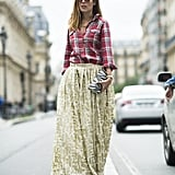 The unexpected came together for a nice pairing in Paris. We loved how this fashion-lover paired a plaid button-up with a glitzy ball skirt. Source: Le 21ème | Adam Katz Sinding