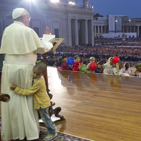 Boy on Stage With Pope