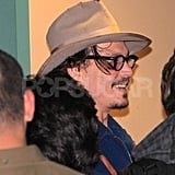 Johnny Depp smiled on his way out of a concert.