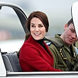 "Kate sat in the cockpit of a Grob 115E ""Tutor"" airplane during a visit to RAF Wittering on Valentine's Day."