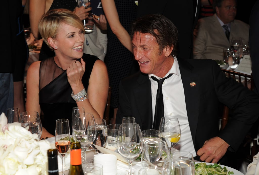 Sean Penn's annual Help Haiti Home fund-raiser was clearly the place for Hollywood's A-listers to let loose ahead of the Golden Globes. The actor hosted his charity bash in LA on Saturday night, and the event drew Gwyneth Paltrow, Julia Roberts, Diane Kruger, Chris Hemsworth, and even Sean's rumored new girlfriend Charlize Theron, who had a place of honor next to Sean at his dinner table. Sean wasn't shy about showing love for Charlize, draping his arms over her chair and even reportedly giving her kisses throughout the night. It looked like the event was a good time for all as Emma Thompson joined Diane and Julia for a chance to rock out to U2, who performed at the bash. Meanwhile, Gwyneth and Charlize let down their glamorous facades to happily sport baseball caps from Sean's charity, J/P. Sean also got a chance to fuss over his rising star daughter, Dylan Penn, who took a break from making the pre-Globes rounds with her mom, Robin Wright, and Robin's new fiancé, Ben Foster, to visit with her dad. There were many more stars at the event last night, so keep reading to see all the fun photos from the party!