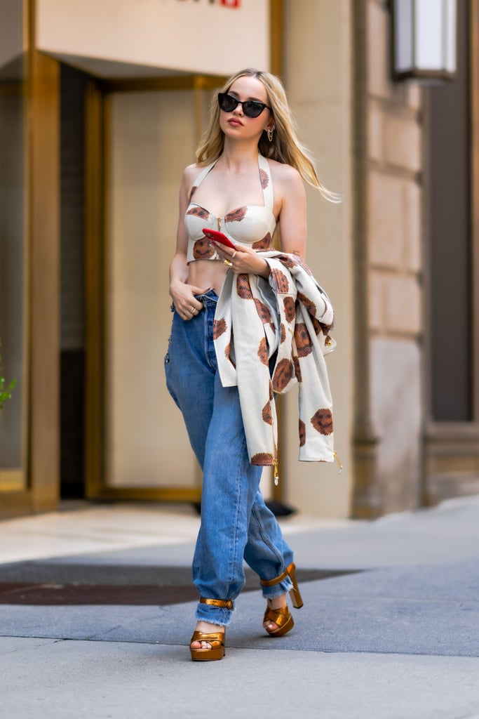 Dove Cameron Wearing Low-Rise Jeans and Moschino Top in NYC