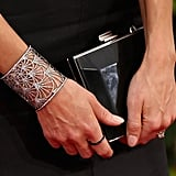 Joanne Froggatt's Jacob & Co. cuff looked regal paired up against her Salvatore Ferragamo box clutch.