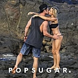 Chris Hemsworth snuck in a kiss with wife Elsa Pataky on the beach in Australia in April 2018.