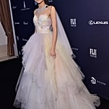 The star later changed into a poufy tiered Marchesa ballgown, which she finished with a Pasquale Bruni diamond necklace and earrings.