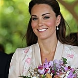 Kate Middleton carried flowers through the botanical gardens in Singapore.