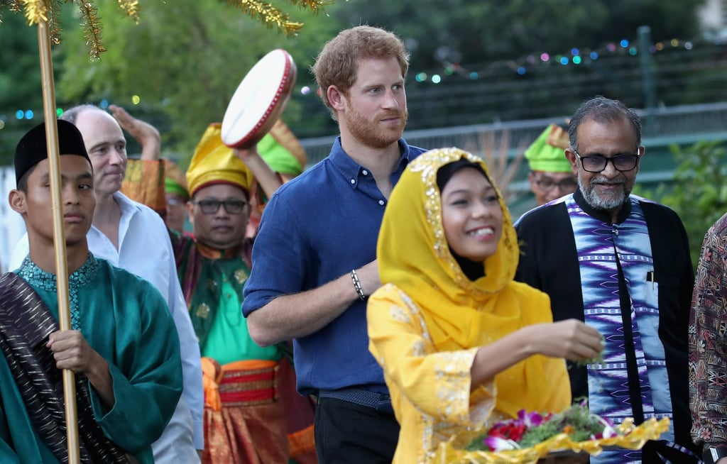 """After meeting with Barack Obama and the team that will represent the UK at the Invictus Games, Prince Harry touched down in Singapore on Sunday to kick off his two-day tour of the country. Upon his arrival, Harry stopped by the Jamiyah Education Centre, where he watched a martial arts match and looked on in awe as the competitors took to the mat. He then took part in iftar (the breaking of the fast during Ramadan) by eating porridge and a dish of dates.  Harry also paid tribute to the victims of Saturday's London Bridge attack. """"Let peace and harmony prevail in communities all over the world,"""" he said as the call to prayer was made by Islamic scholar Muhammad Rafiuddin Ismail. This is Harry's first time in Singapore, and he is expected to attend an Action for Aids reception as well as take part in the Sentebale Royal Salute Polo Cup."""