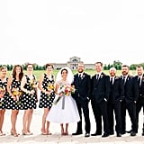 To complement the polka dotted top of the bride's dress, these bridesmaids wore short black and white polka dot dresses.