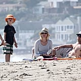 Naomi Watts and Liev Schreiber laid out while their boys played.