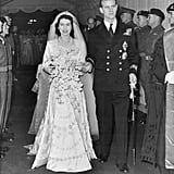 """Their union was frowned upon by many. Queen Elizabeth II and Prince Philip, who are actually cousins, didn't have an easy journey to the aisle. Due to Philip's arrogance and lack of funds, it was widely considered that the future Queen should pick another suitor. Fortunately Elizabeth ignored the doubters, and moved forward with the wedding.  Prince Philip planned a sweet proposal. While walking around the grounds of Balmoral Castle (in Scotland), Philip popped the question. Since Elizabeth's parents didn't approve at the time, they had to keep it a secret for quite a while.  The Queen's engagement and wedding rings are both stunners. Prince Philip proposed with a 3 carat diamond and platinum engagement ring crafted by Philip Antrobus. The jewelry company took diamonds from a tiara belonging to Prince Philip's mother, Princess Andrew of Greece, adding a special familial touch. For her wedding ring, a nugget of Welsh gold from the Clogau St David's mine, near Dolgellau, was used.  Philip had not one, but two bachelor parties. Or """"stag parties,"""" as they're called in the UK. The night before the wedding, Philip hosted a party at the Dorchester open to the press, who were invited to cover the protocol of the day. It reportedly got a little out of hand: Philip and his friends ended up ripping the flashbulbs off of a few cameras and stomping them on the ground before moving on to a private stag party at London's Belfry Club."""