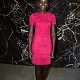 At Miu Miu's Spring 2014 show during Paris Fashion Week, all Lupita Nyong'o needed to pop was a bright fuchsia mini-dress and her svelte figure.