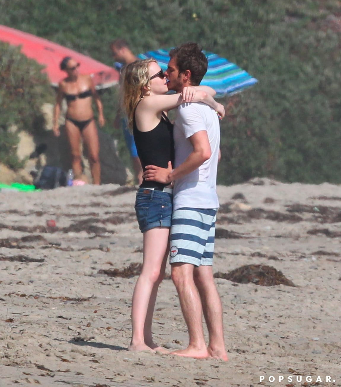 Emma Stone celebrated Andrew Garfield's birthday with lots of steamy kisses on the beach in Malibu, CA, back in August 2012.