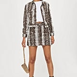 For example, if you're feeling fierce, try an animal print denim jacket ($85) and a matching denim miniskirt ($60) — you'll be tackling two trends at once with the snakeskin!