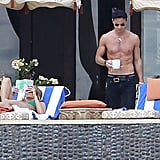 Jennifer Aniston Kisses Justin Poolside During a Bikini-Filled NYE