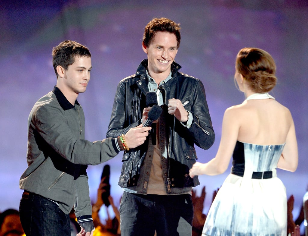 Emma Watson accepted her trailblazer honour from Logan Lerman and Eddie Redmayne at the MTV Movie Awards.