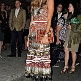 Anna Dello Russo rocked an Altuzarra dress straight from the Fall '12 runway — pairing the longer dress with a black leather boot. Are you a fan?