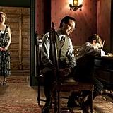 Gretchen Mol, as Gillian Darmody, watches on as Richard Harrow (Jack Huston) bonds with Tommy (Brady Noon).