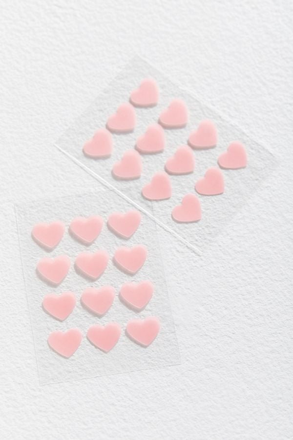 Wearing a pimple patch doesn't exactly make me feel cute, but then again, I've never worn a heart-shaped one. After discovering these Truly Organic Heart-Shaped Acne Patches ($9), I'm inspired to toss out my blah-looking dots in favor of these selfie-worthy cuties. As sweet and innocent-looking as they are, these patches also get the job done, according to online reviews. They contain hydrocolloid, which is effective at drawing out fluid and getting all the gunk out of a blemish (a gross but satisfying activity).  Keeping some kind of pimple patches on hand is always a good idea, and these just happen to be an adorable Valentine's Day gift — for your friends or for yourself. Shop the aesthetically pleasing skincare product from Urban Outfitters and Truly Organic ahead, and then check out some more of our favourite acne spot treatments.         Related:                                                                                                           Kiss Breakouts Goodbye With These 15 Acne-Clearing Face Masks