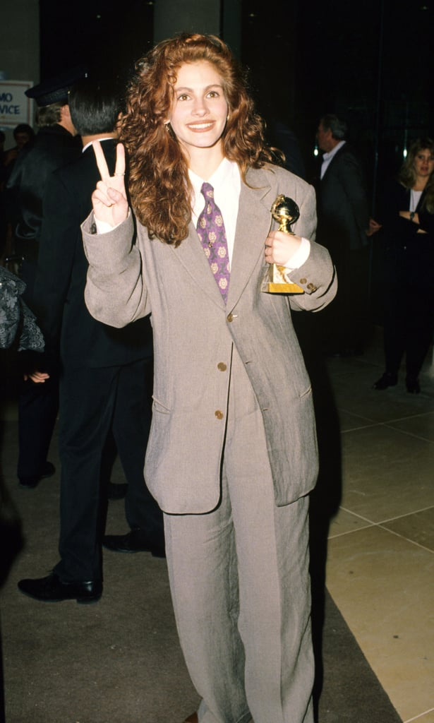 JJulia's iconic gray suit was complete with a purple floral tie at the Golden Globe Awards in 1990.