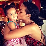 Rihanna gave a smooch to a cute little girl. Source: Instagram user badgalriri