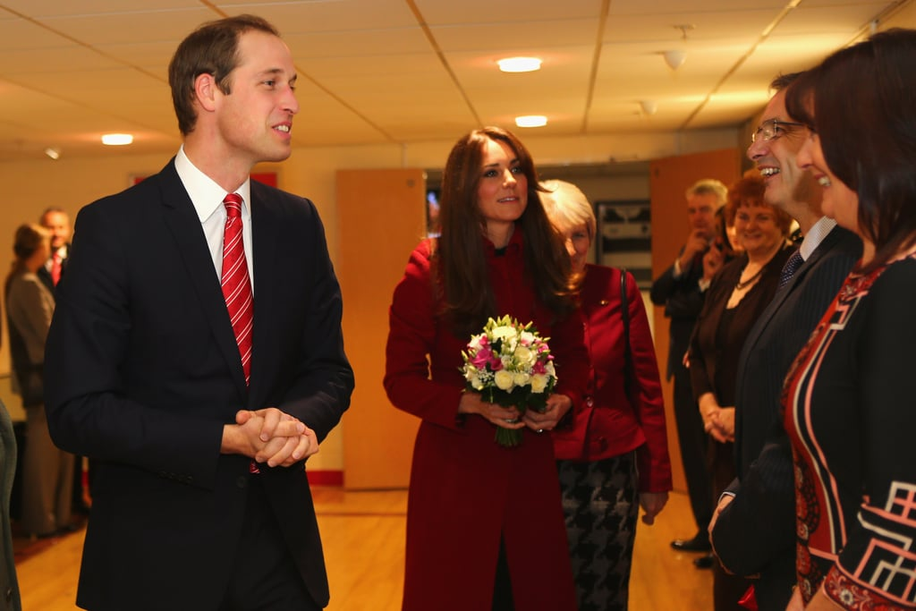 Prince William and wife Kate were together last night to visit with rugby players and executives at Cardiff's Millennium Stadium. William, vice patron of the Welsh Rugby Union, and Kate first attended a reception for the Welsh Rugby Charitable Trust, which supports injured players, and said hello to the First Minister of Wales Carwyn Jones. After some meeting and greeting, William and Kate took their seats to watch the match between Wales and New Zealand. Kate was decked out in a red L.K.Bennett coat and carrying a Gucci clutch for the occasion and evidently was quite fond of the Bennett piece —she kept it on during the reception, while most others removed their outerwear. Despite Prince William and Kate's support, the Welsh team lost to visiting New Zealand 33 to 10. Kate has a busy week ahead, as she's due to attended Tuesday's opening of a new gallery at London's Natural History Museum.