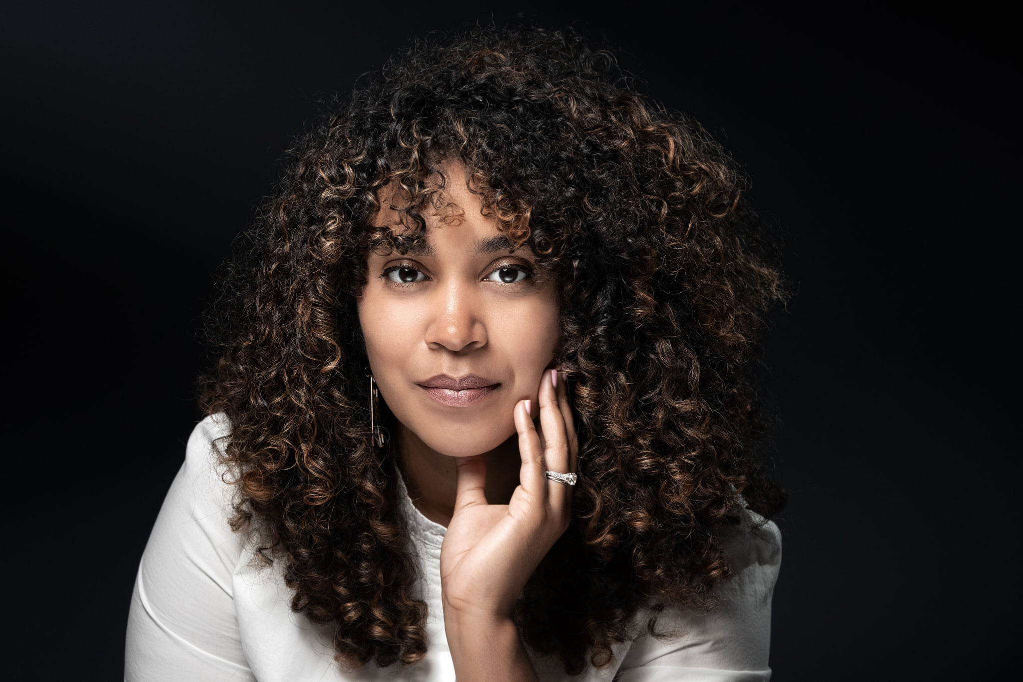 Dominican-American poet, author and writer Elizabeth Acevedo poses during a photo session in Paris on September 17, 2019. (Photo by JOEL SAGET / AFP)        (Photo credit should read JOEL SAGET/AFP/Getty Images)