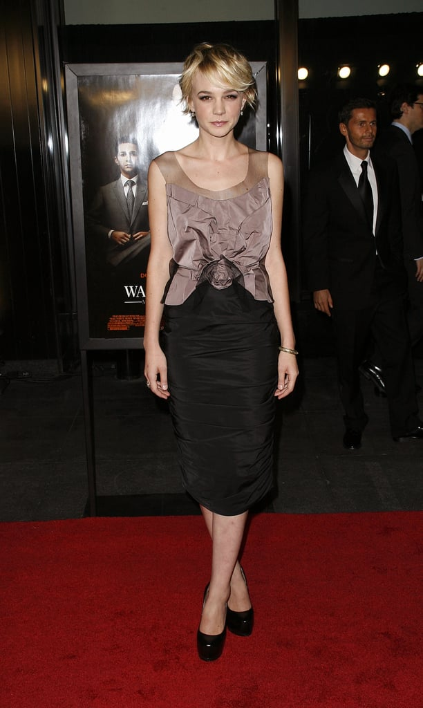 For the NYC premiere of Wall Street: Money Never Sleeps, Carey Mulligan styled a two-tone Nina Ricci dress — with a rosette-detailed bodice and ruched skirt — with patent Yves Saint Laurent platforms.