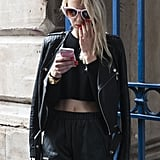 Powder pink accessories offset her all-black look.