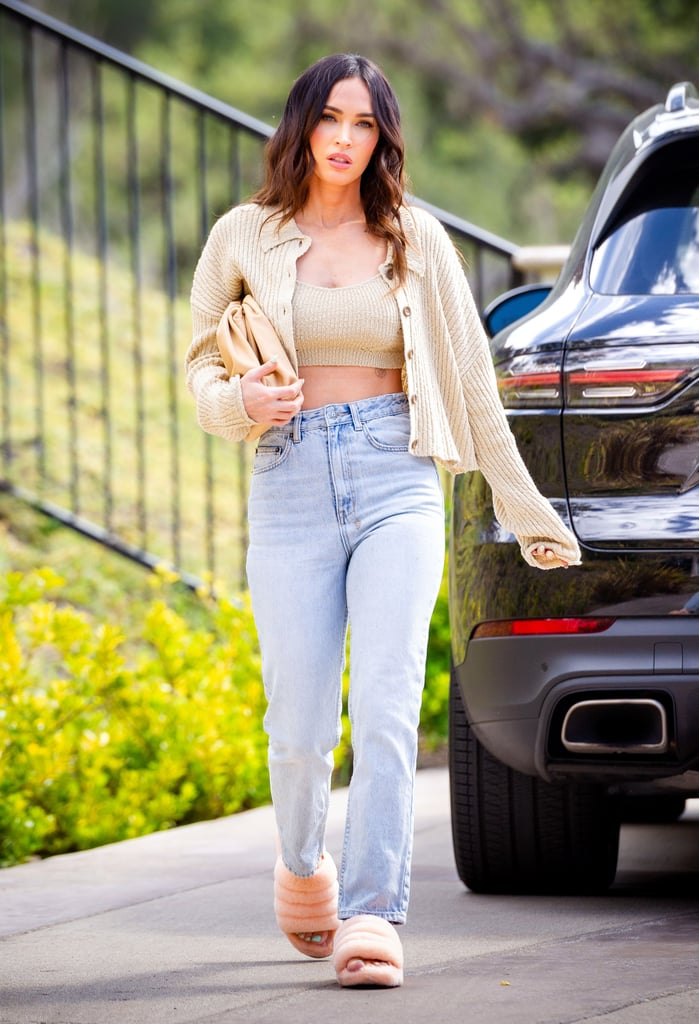 I have a confession to make: I'm obsessed with Megan Fox's style. There's no denying that the 34-year-old actress has always been gorgeous, but she's really stepped up her fashion game this year. Ever since she started working with Hailey Bieber's stylist, Maeve Reilly, Megan has mastered the art of an effortlessly chic look. She knows how to make an outfit sexy without trying too hard, she's the queen of all-black ensembles, and she even coordinates her looks with boyfriend Machine Gun Kelly from time to time.  Personally, I've been living in sweatpants and hoodies this past year, so I'm taking cues from Megan as I start purchasing real clothes again. Not going to lie, the Urban Outfitters sweater set she wore last month may already be hanging in my closet. If you, too, are looking for some fashion inspiration, check out Megan's best outfits from 2021 so far, ahead.      Related:                                                                                                           Machine Gun Kelly's Birthday Turned Into a Double Date With Megan Fox, Kourtney, and Travis