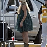 Anna Kournikova wore a sundress, boots, and hat.