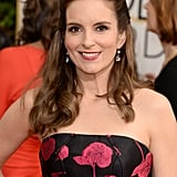 Sporting a curled half-up 'do, host Tina Fey was part business, part party.