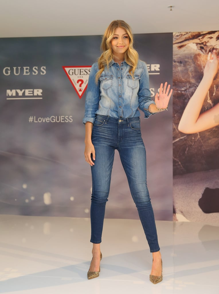 Wearing Guess jeans with a denim top and gold heels.