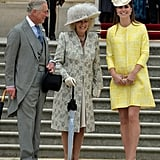 Kate joined Prince Charles and Camilla, Duchess of Cornwall, at Queen Elizabeth II's annual garden party on May 22, 2013. The expectant mom wore a sunny tweed Emilia Wickstead coat and a Jane Corbett headpiece.