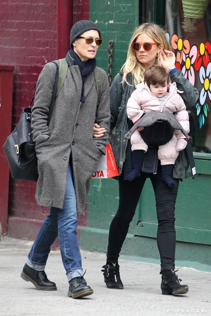 Sienna Miller carried daughter Marlowe Sturridge for a day of shopping with pal Robin Wright in NYC.