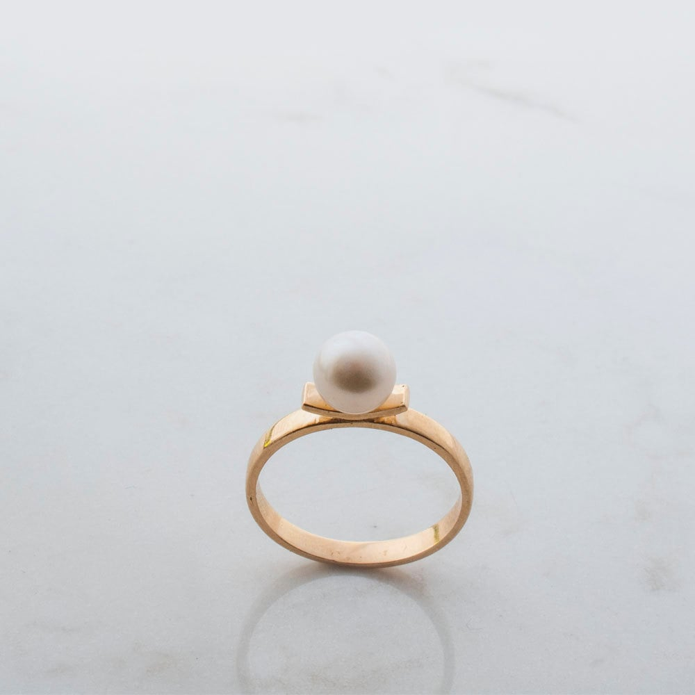 This pearl ring ($325) is reminiscent of those back in the '30s and '40s thanks to the simple and elegant setting.