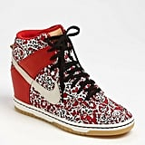 """With this """"hidden"""" insole wedge sneaker with a whole lot of printed attitude, we instantly think of NYC cool-girls Azealia Banks and Vashtie when we see this sneaker. Nike Dunk Sky Hi Liberty Wedge Sneaker ($130)"""
