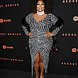 One of our favorite Lizzo looks is this front-slit zebra-print cocktail dress, which she paired with an glimmery high-collar necklace and a black faux fur shrug. While it's one of her classiest looks to date, Lizzo made the look her own with lots of bling and a gorgeous pink manicure.