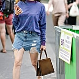 The ultimate errands outfit: a denim miniskirt, striped tee, and sneakers.