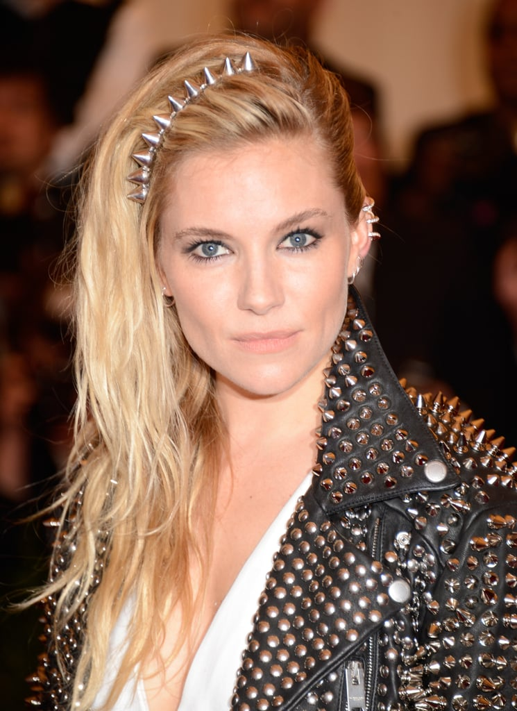 At the punk-theme Met Gala, Sienna Miller got into the spirit of the evening with her studded headband and mock undercut.
