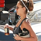 Jessica Alba keeps a good grip on her white BlackBerry after a workout.