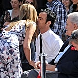 Jennifer Aniston greeted Justin Theroux with a kiss at her Hollywood Walk of Fame ceremony in LA in February.