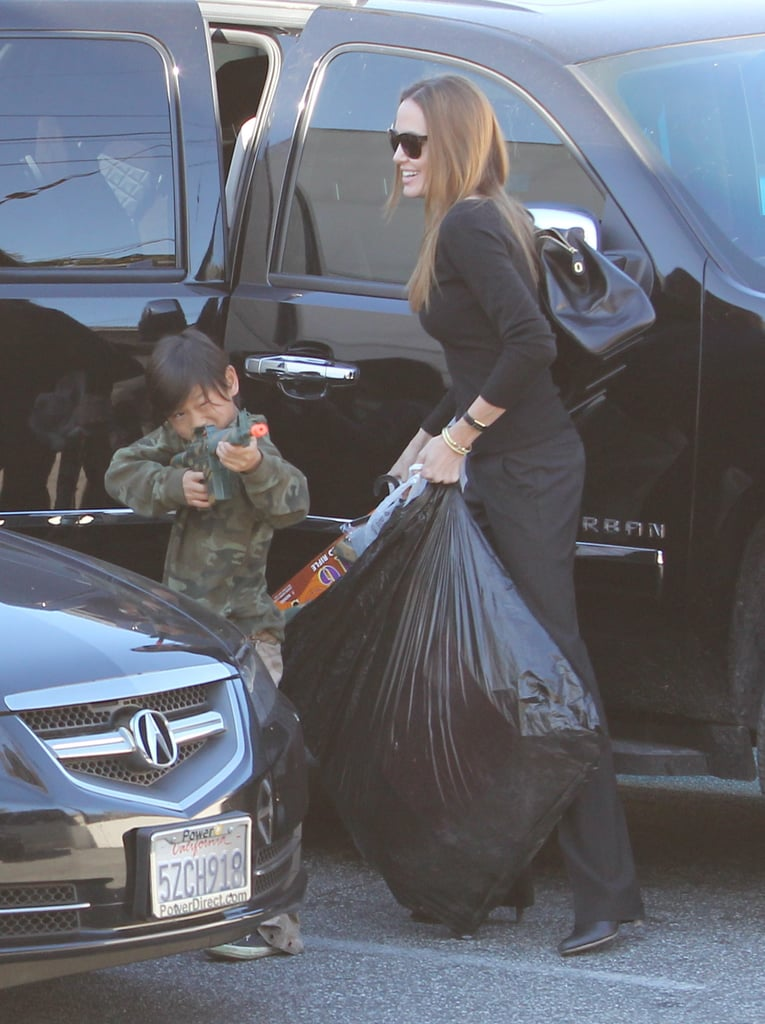 Pax played with a toy gun in LA with mom, Angelina Jolie.