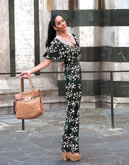 Craving the all-out '70s effect? Go for it with a printed jumper and platform heels. This one works because the jumpsuit is cut slim enough to feel wearable and the platforms are still walkable, not costume-like. Photo courtesy of Lookbook.nu