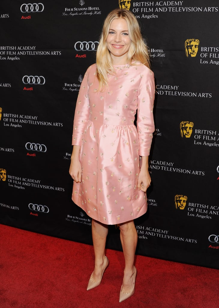 Sienna Miller traded her bohemian street style for a ladylike pink floral Erdem dress and nude pumps on the red carpet at the 2013 BAFTAs. Don't be afraid to pick a similar light pink dress for your romantic festivities.