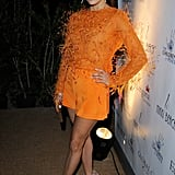 Eva Longoria wasn't afraid to embrace bold color or texture with this feathered, tangerine-hued top-and-short set by Emilio Pucci at the afterparty for her Global Gift Gala.
