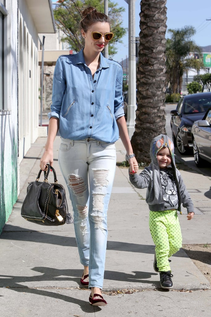 Miranda Kerr held hands with her 2-year-old son, Flynn Bloom, while out for a walk in Hollywood yesterday afternoon. The duo are temporarily based at home in LA with Orlando Bloom, Flynn's dad and Miranda's husband. The year began in a busy way for Miranda, as she flew around the world on modelling assignments. On Easter, the Bloom-Kerrs returned to California following their latest family holiday. At the moment, Miranda's enjoying being in one place and indulging in some close-to-home activities like baking — she made gluten-free muffins last week — and fishing, as she and Flynn did yesterday.