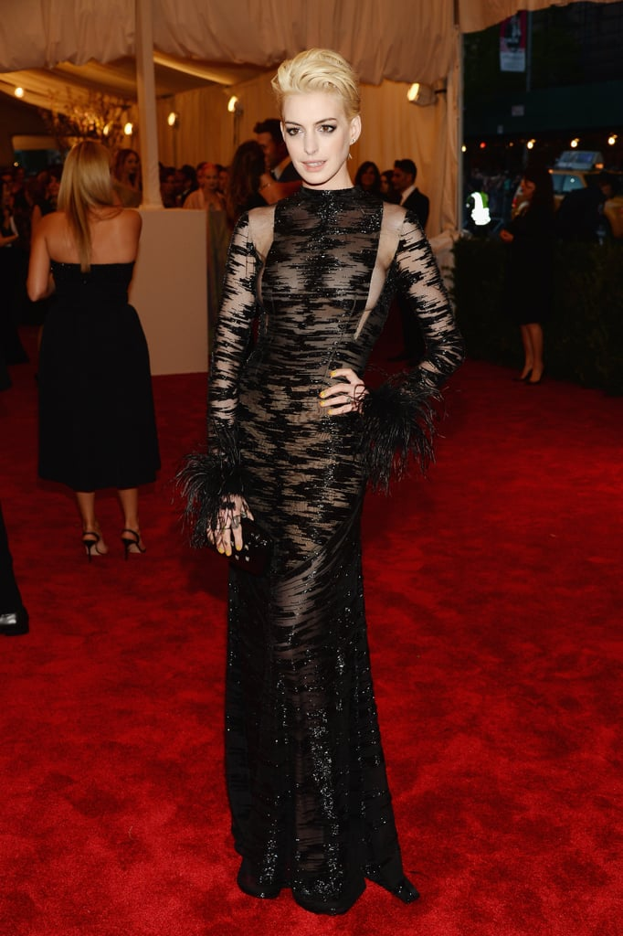 Anne Hathaway complemented her new platinum hair with a sheer Valentino gown.