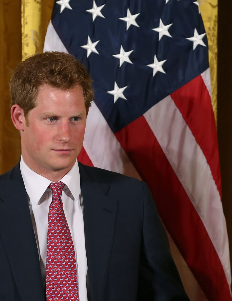 Prince Harry stood next to an American flag while meeting with Michelle Obama in Washington DC on Thursday.