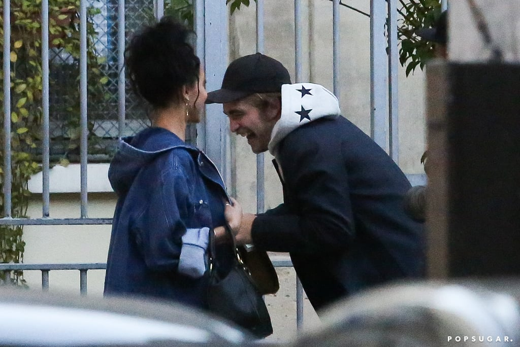"""It looks like Robert Pattinson and FKA Twigs are still going strong! The couple was shopping around Paris on Tuesday before arriving back at their hotel. Rob and FKA Twigs have been showing PDA in the City of Light during their stay, with one observer noticing how comfortable the pair seemed while trying on clothes at a store in the Marais district: """"They were trying things on, making suggestions to one another, and he seemed to be really having a good time. He looks like he's really in love."""" The source also noted that FKA Twigs is """"ridiculously cute"""" and that it looked like Rob was """"in a normal relationship, enjoying it."""" They added, """"Honestly, it was miles and miles away from what it was like when he was with Kristen [Stewart]."""" Rob and FKA Twigs were first spotted together in early September. While neither star has confirmed their romance, the singer did take haters to task last month when they started to send her racist messages on Twitter because she's dating the Twilight star."""