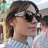 Alexa Chung sported sculpted tortoise 1950s-inspired frames by Karen Walker. The slightly rectangular shape was a flattering choice that gave her face an ample amount of sun protection — key for a day on the festival grounds.